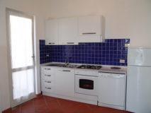 Küchenbereich mit Gartenzugang | Ferienhaus Elba Meerblick